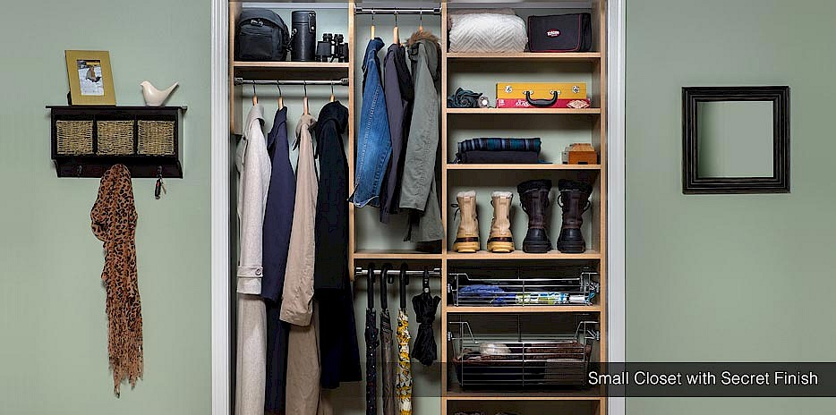 This small entryway closet is perfect for coats, umbrellas, shoes and other accessories that make a small closet a big space saver!