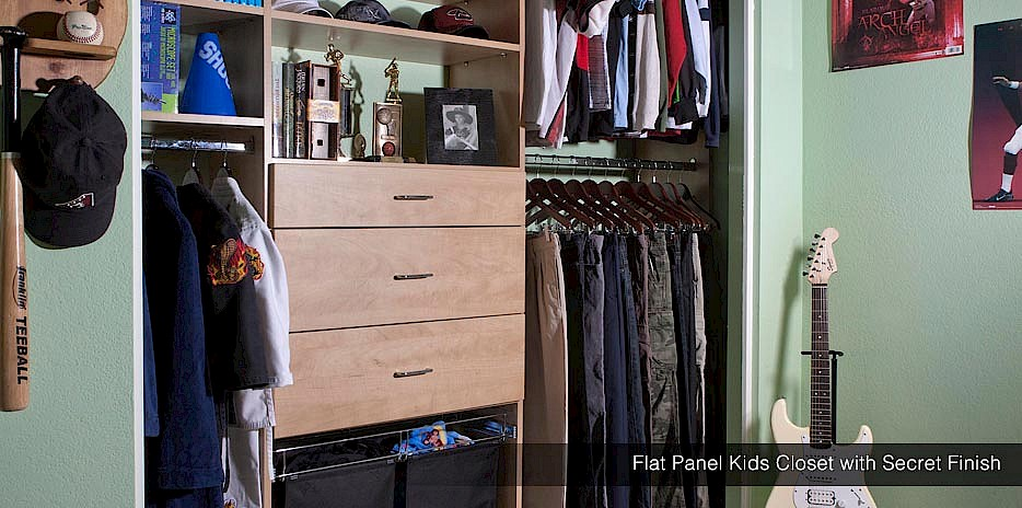 This gorgeous flat panel kids closet is the perfect place for a boy to keep all his favorite items!