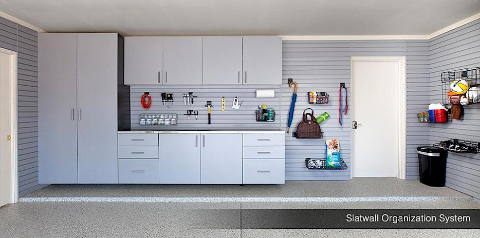 This slatwall organization system wraps around the entire garage, offering shelving solutions in every corner!